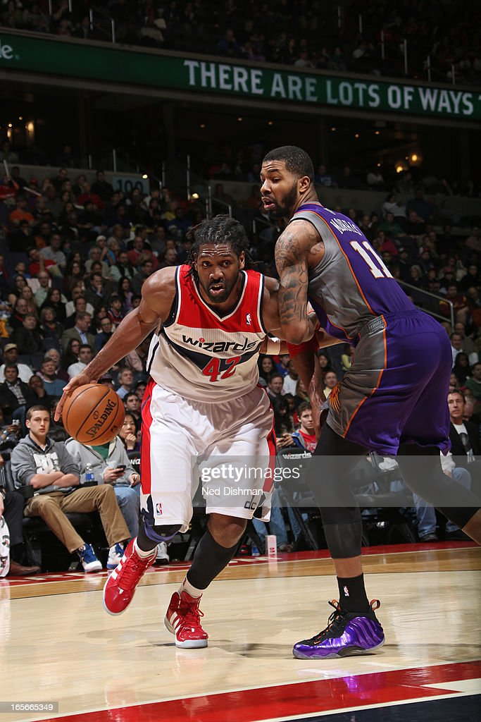 Nene #42 of the Washington Wizards drives to the basket against the Phoenix Suns at the Verizon Center on March 16, 2013 in Washington, DC.