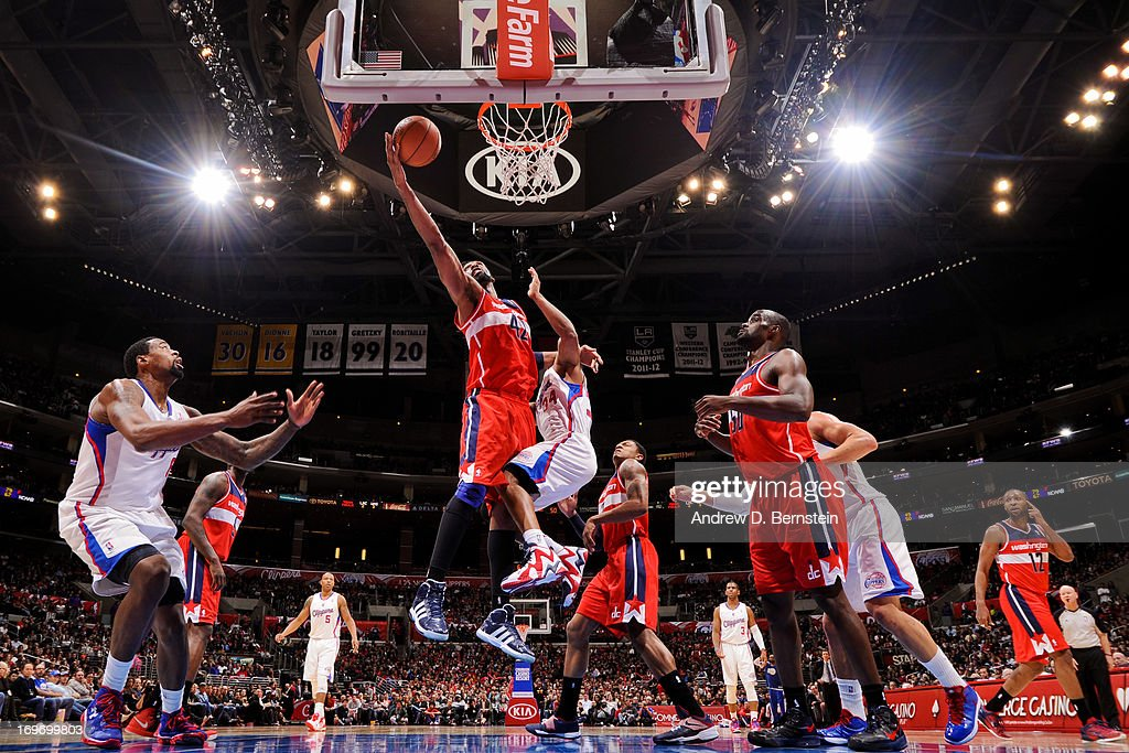 Nene #42 of the Washington Wizards drives to the basket against <a gi-track='captionPersonalityLinkClicked' href=/galleries/search?phrase=Willie+Green&family=editorial&specificpeople=201653 ng-click='$event.stopPropagation()'>Willie Green</a> #34 of the Los Angeles Clippers at Staples Center on January 19, 2013 in Los Angeles, California.