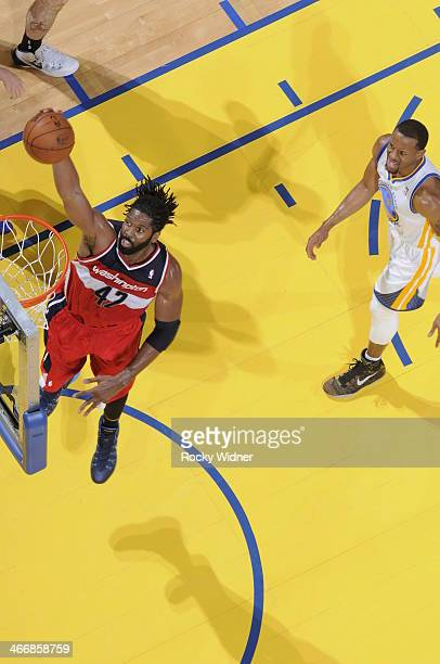 Nene of the Washington Wizards dunks against the Golden State Warriors on January 28 2014 at Oracle Arena in Oakland California NOTE TO USER User...