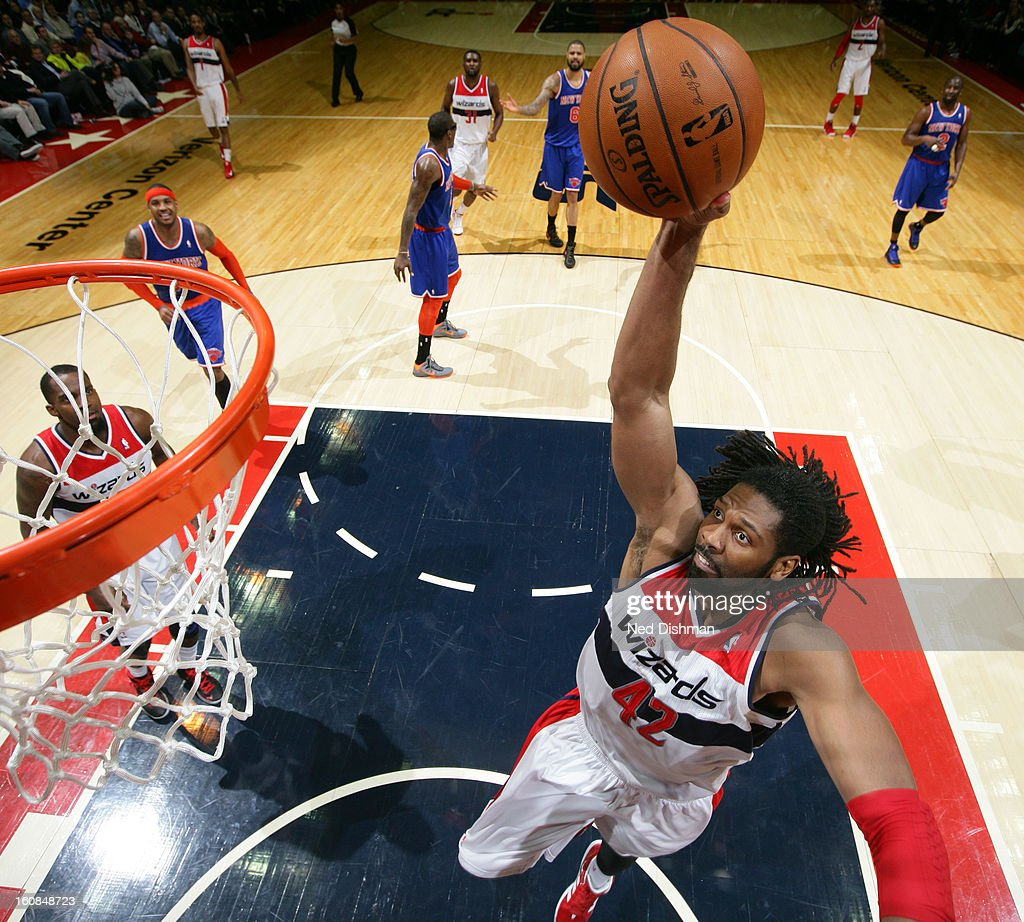 Nene #42 of the Washington Wizards dunks against the New York Knicks during the game at the Verizon Center on February 6, 2013 in Washington, DC.