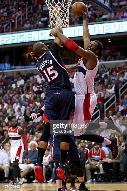 Nene of the Washington Wizards dunks over Al Horford of the Atlanta Hawks during the first half in Game Four of the Eastern Conference Semifinals of...