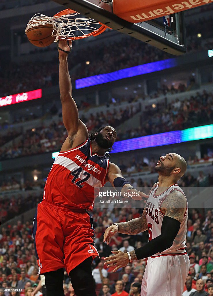 Nene #42 of the Washington Wizards dunks over Carlos Boozer #5 of the Chicago Bulls in Game One of the Eastern Conference Quarterfinals during the 2014 NBA Playoffs at the United Center on April 20, 2014 in Chicago, Illinois.
