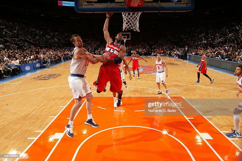 Nene #42 of the Washington Wizards dunks the ball over <a gi-track='captionPersonalityLinkClicked' href=/galleries/search?phrase=Steve+Novak&family=editorial&specificpeople=693015 ng-click='$event.stopPropagation()'>Steve Novak</a> #16 of the New York Knicks on November 30 2012 at Madison Square Garden in New York City.