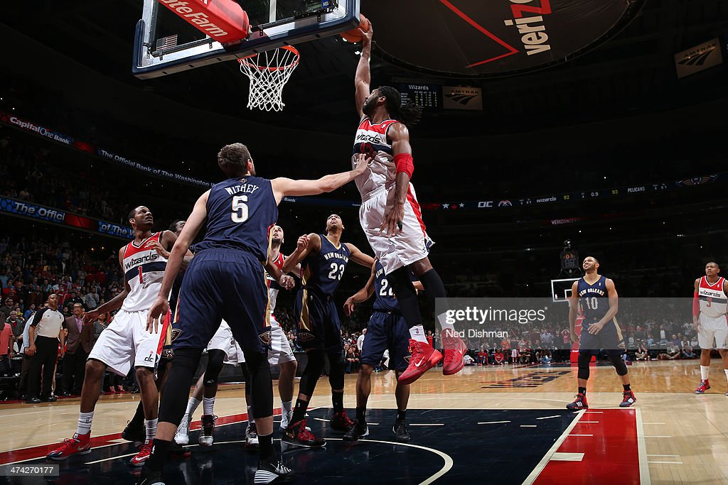 Nene #42 of the Washington Wizards dunks the game-winning basket against Jeff Withey #5 of the New Orleans Pelicans during the game at the Verizon Center on February 22, 2014 in Washington, DC.