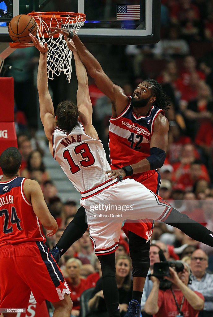 Nene #42 of the Washington Wizards fouls <a gi-track='captionPersonalityLinkClicked' href=/galleries/search?phrase=Joakim+Noah&family=editorial&specificpeople=699038 ng-click='$event.stopPropagation()'>Joakim Noah</a> #13 of the Chicago Bulls in Game One of the Eastern Conference Quarterfinals during the 2014 NBA Playoffs at the United Center on April 20, 2014 in Chicago, Illinois.