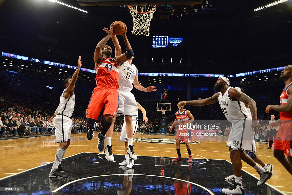 Nene #42 of the Washington Wizards goes to the basket against Brook Lopez #11 of the Brooklyn Nets on March 8, 2013 at the Barclays Center in Brooklyn, New York.