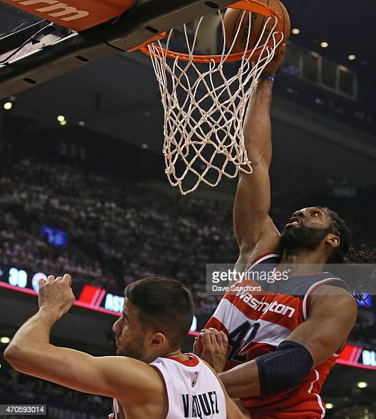 Nene of the Washington Wizards goes up for a dunk in Game Two of the Eastern Conference Quarterfinals against the Toronto Raptors during the 2015 NBA...