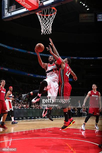 Nene of the Washington Wizards goes up for a shot against the Miami Heat on March 6 2015 at Verizon Center in Washington DC NOTE TO USER User...