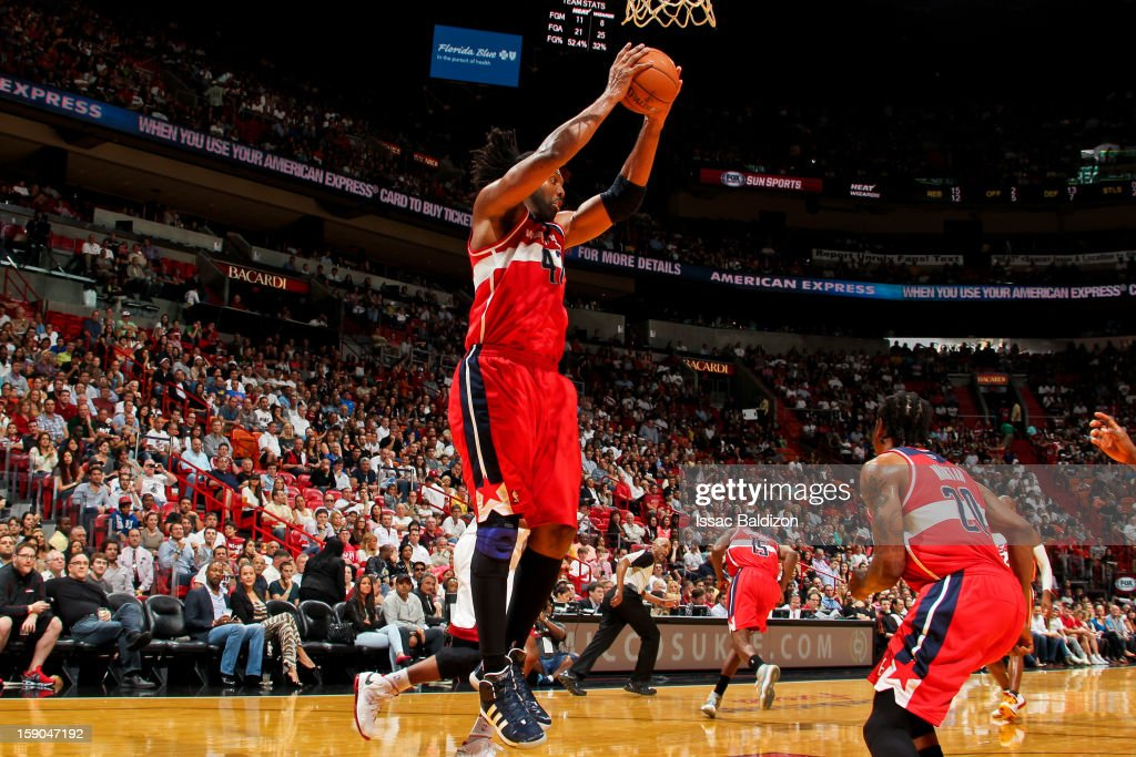 Nene #42 of the Washington Wizards grabs a rebound against the Miami Heat on January 6, 2013 at American Airlines Arena in Miami, Florida.