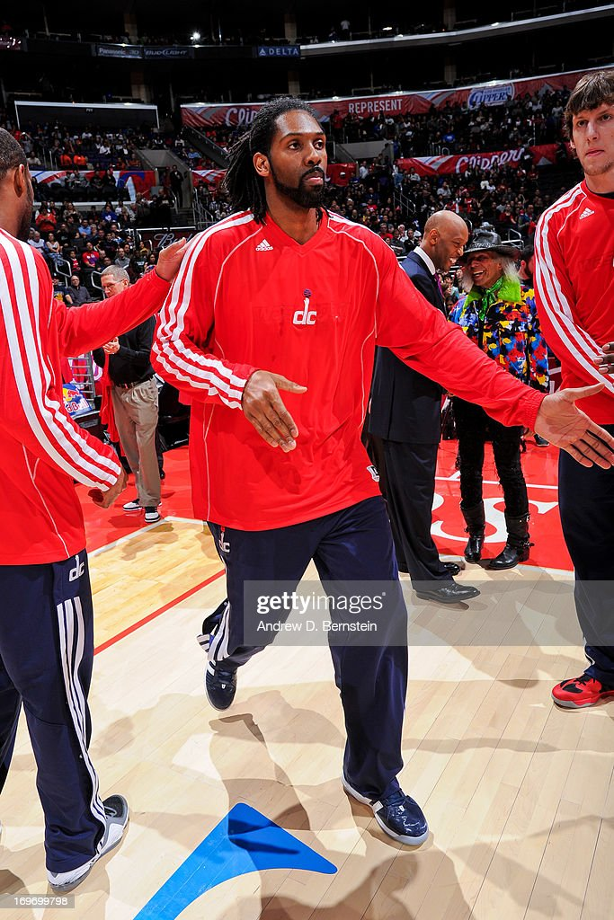 Nene #42 of the Washington Wizards greets teammates before playing against the Los Angeles Clippers at Staples Center on January 19, 2013 in Los Angeles, California.