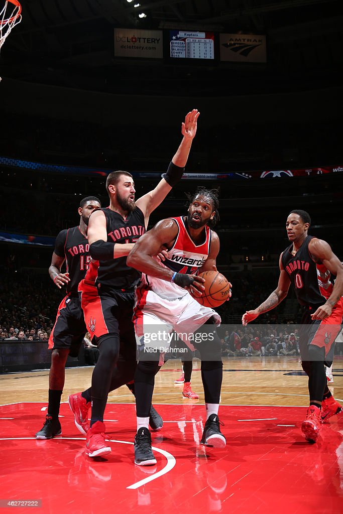 Nene #42 of the Washington Wizards handles the ball against Jonas Valanciunas #17 of the Toronto Raptors on January 31, 2015 at Verizon Center in Washington, DC.