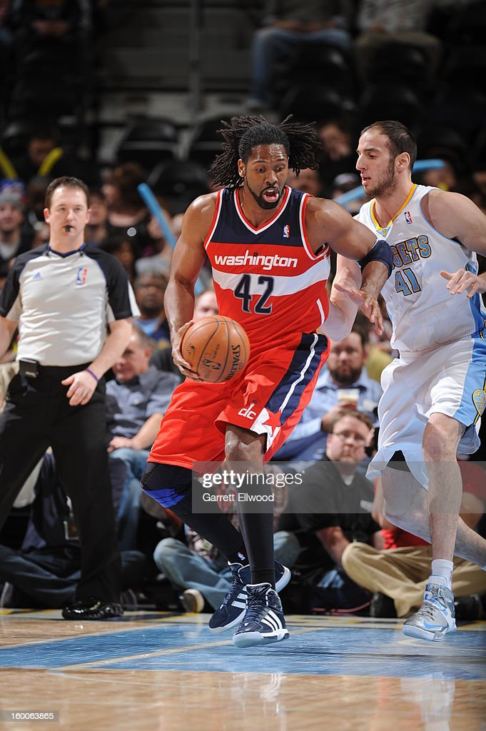 Nene #42 of the Washington Wizards handles the ball against Kosta Koufos #41 of the Denver Nuggets on January 18, 2013 at the Pepsi Center in Denver, Colorado.