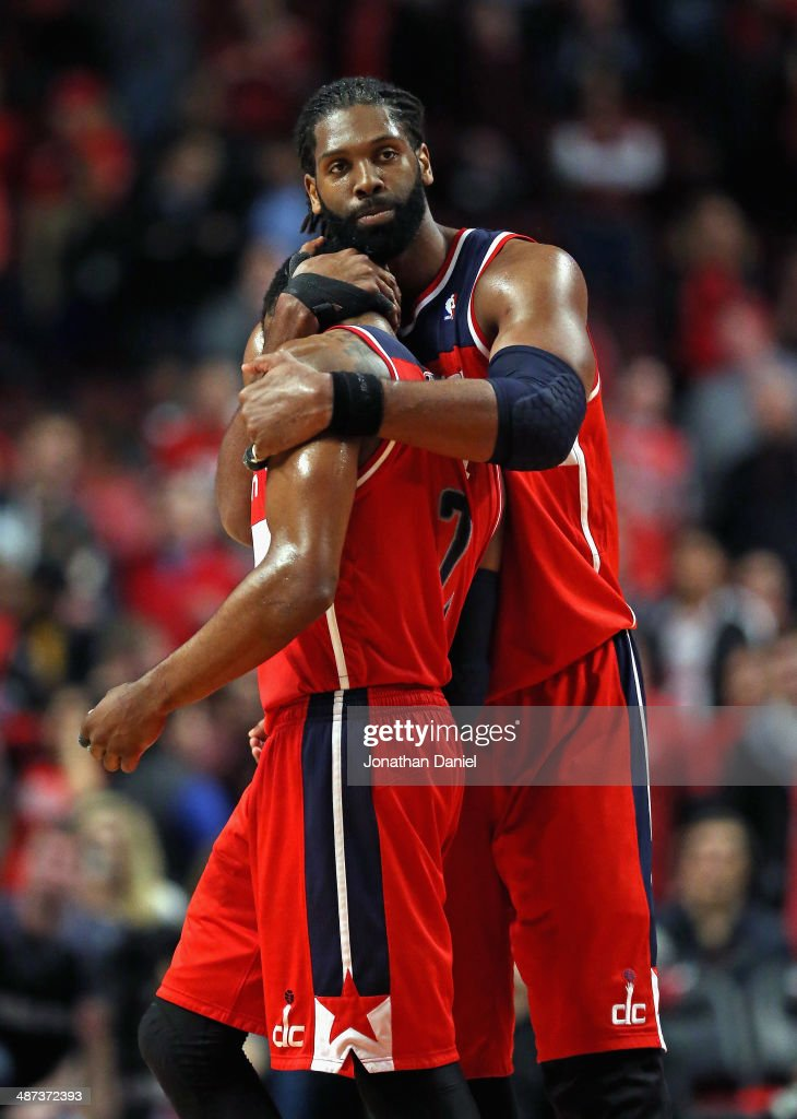 Nene #42 of the Washington Wizards hugs teammate <a gi-track='captionPersonalityLinkClicked' href=/galleries/search?phrase=John+Wall&family=editorial&specificpeople=2265812 ng-click='$event.stopPropagation()'>John Wall</a> #2 at the end of the game against the Chicago Bulls in Game Five of the Eastern Conference Quarterfinals during the 2014 NBA Playoffs at the United Center on April 29, 2014 in Chicago, Illinois. The Wizards defeated the Bulls 75-69 to win the series four game to one.