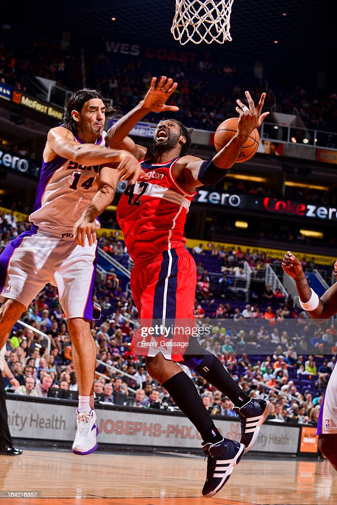 Nene #42 of the Washington Wizards loses control of the ball against <a gi-track='captionPersonalityLinkClicked' href=/galleries/search?phrase=Luis+Scola&family=editorial&specificpeople=2464749 ng-click='$event.stopPropagation()'>Luis Scola</a> #14 of the Phoenix Suns on March 20, 2013 at U.S. Airways Center in Phoenix, Arizona.