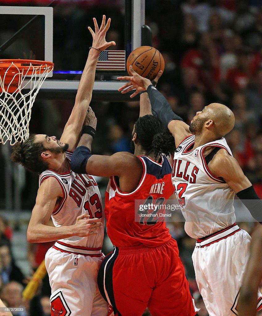 Nene #42 of the Washington Wizards puts up a successful shot between <a gi-track='captionPersonalityLinkClicked' href=/galleries/search?phrase=Joakim+Noah&family=editorial&specificpeople=699038 ng-click='$event.stopPropagation()'>Joakim Noah</a> #13 (L) and <a gi-track='captionPersonalityLinkClicked' href=/galleries/search?phrase=Taj+Gibson&family=editorial&specificpeople=4029461 ng-click='$event.stopPropagation()'>Taj Gibson</a> #22 of the Chicago Bulls in Game Five of the Eastern Conference Quarterfinals during the 2014 NBA Playoffs at the United Center on April 29, 2014 in Chicago, Illinois. The Wizards defeated the Bulls 75-69 to win the series four games to one.