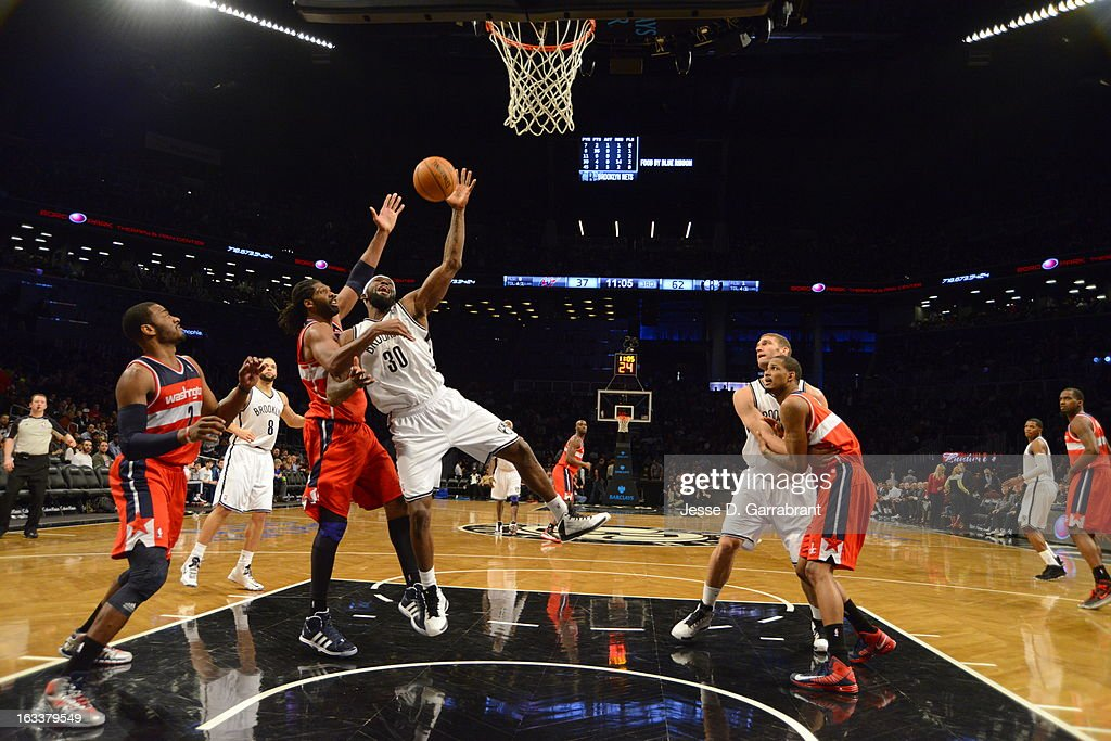 Nene #42 of the Washington Wizards reaches for a rebound against <a gi-track='captionPersonalityLinkClicked' href=/galleries/search?phrase=Reggie+Evans&family=editorial&specificpeople=202254 ng-click='$event.stopPropagation()'>Reggie Evans</a> #30 of the Brooklyn Nets on March 8, 2013 at the Barclays Center in Brooklyn, New York.