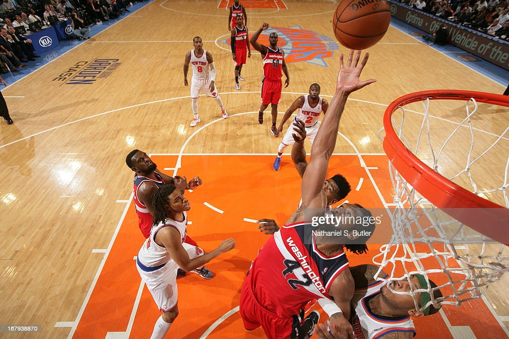Nene #42 of the Washington Wizards reaches for a rebound against the New York Knicks on April 9, 2013 at Madison Square Garden in New York City.