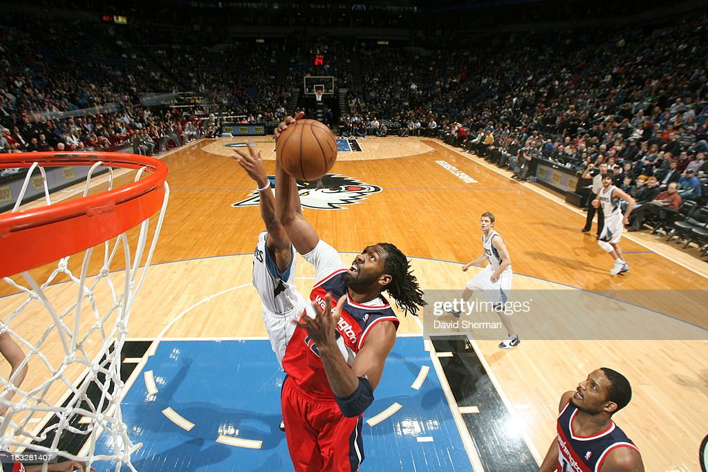 Nene #42 of the Washington Wizards rebounds against the Minnesota Timberwolves on March 6, 2013 at Target Center in Minneapolis, Minnesota.