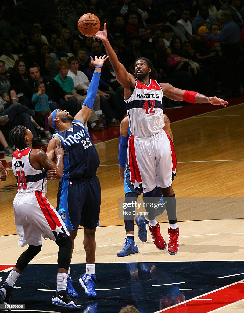 Nene #42 of the Washington Wizards rebounds against <a gi-track='captionPersonalityLinkClicked' href=/galleries/search?phrase=Vince+Carter&family=editorial&specificpeople=201488 ng-click='$event.stopPropagation()'>Vince Carter</a> #25 of the Dallas Mavericks during the game at the Verizon Center on January 1, 2013 in Washington, DC.