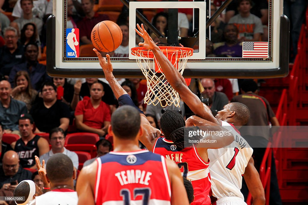 Nene #42 of the Washington Wizards shoots a layup against Chris Bosh #1 of the Miami Heat on January 6, 2013 at American Airlines Arena in Miami, Florida.