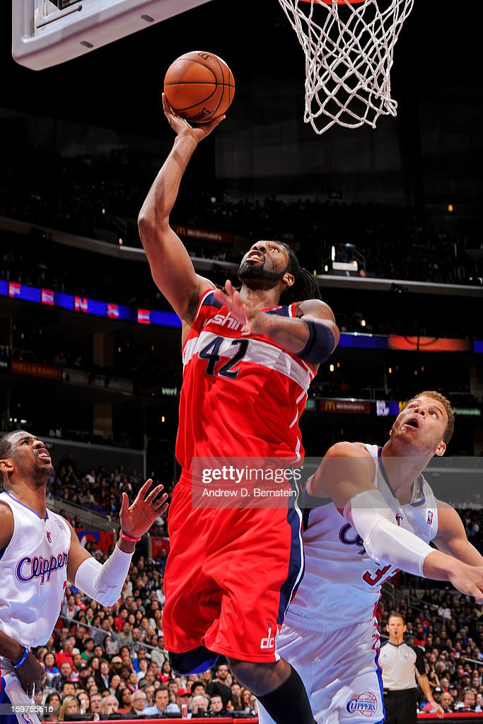 Nene #42 of the Washington Wizards shoots a layup against Chris Paul #3 and Blake Griffin #32 of the Los Angeles Clippers at Staples Center on January 19, 2013 in Los Angeles, California.