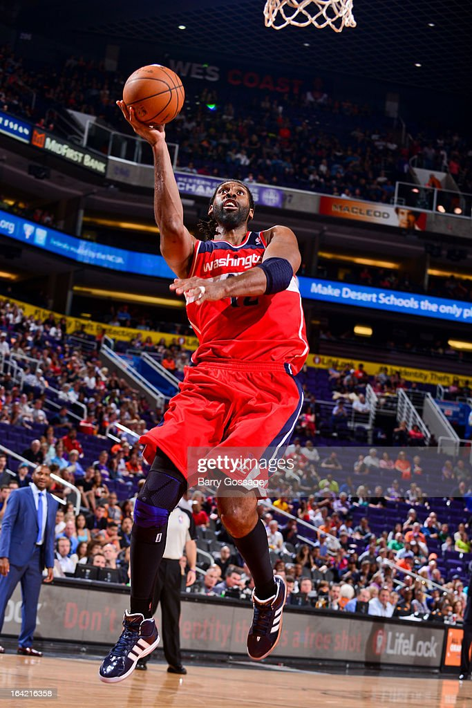 Nene #42 of the Washington Wizards shoots a layup against the Phoenix Suns on March 20, 2013 at U.S. Airways Center in Phoenix, Arizona.