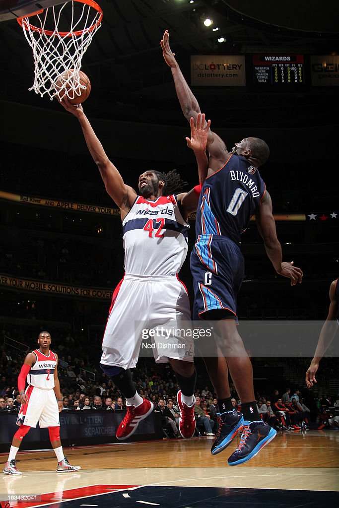 Nene #42 of the Washington Wizards shoots against Bismack Biyombo #0 of the Charlotte Bobcats during the game at the Verizon Center on March 9, 2013 in Washington, DC.