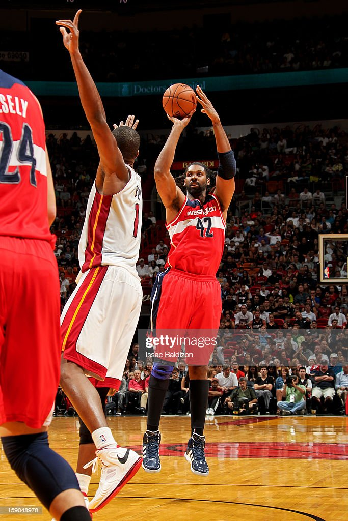 Nene #42 of the Washington Wizards shoots against <a gi-track='captionPersonalityLinkClicked' href=/galleries/search?phrase=Chris+Bosh&family=editorial&specificpeople=201574 ng-click='$event.stopPropagation()'>Chris Bosh</a> #1 of the Miami Heat on January 6, 2013 at American Airlines Arena in Miami, Florida.
