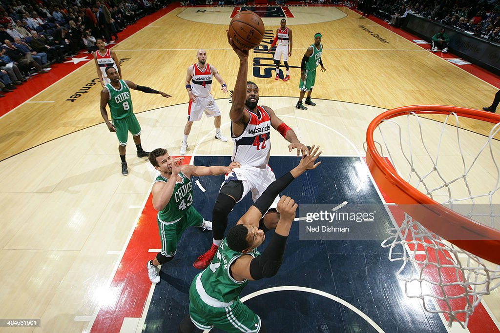 Nene #42 of the Washington Wizards shoots against <a gi-track='captionPersonalityLinkClicked' href=/galleries/search?phrase=Jared+Sullinger&family=editorial&specificpeople=6866665 ng-click='$event.stopPropagation()'>Jared Sullinger</a> #7 of the Boston Celtics during the game at the Verizon Center on January 22, 2014 in Washington, DC.