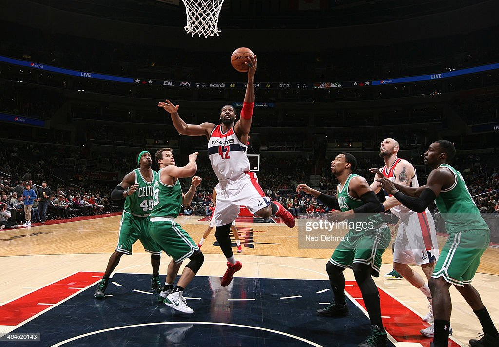 Nene #42 of the Washington Wizards shoots against <a gi-track='captionPersonalityLinkClicked' href=/galleries/search?phrase=Kris+Humphries&family=editorial&specificpeople=209199 ng-click='$event.stopPropagation()'>Kris Humphries</a> #43 of the Boston Celtics during the game at the Verizon Center on January 22, 2014 in Washington, DC.