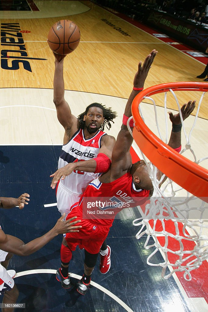 Nene #42 of the Washington Wizards shoots against <a gi-track='captionPersonalityLinkClicked' href=/galleries/search?phrase=Lamar+Odom&family=editorial&specificpeople=201519 ng-click='$event.stopPropagation()'>Lamar Odom</a> #7 of the Los Angeles Clippers on February 4, 2013 at the Verizon Center in Washington, DC.
