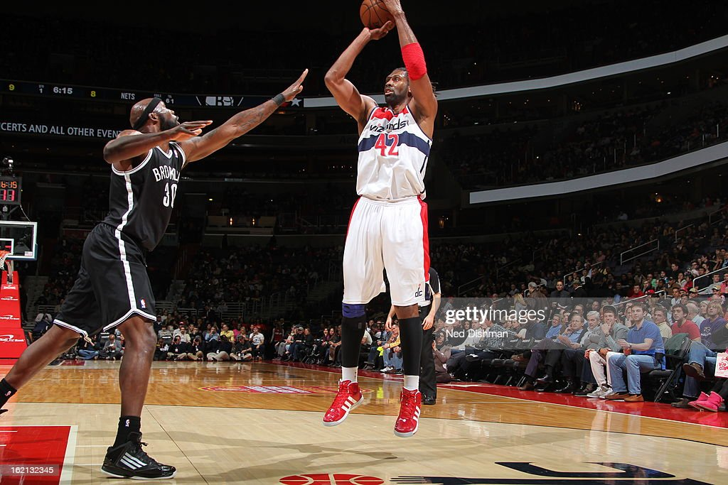 Nene #42 of the Washington Wizards shoots against <a gi-track='captionPersonalityLinkClicked' href=/galleries/search?phrase=Reggie+Evans&family=editorial&specificpeople=202254 ng-click='$event.stopPropagation()'>Reggie Evans</a> #30 of the Brooklyn Nets on February 8, 2013 at the Verizon Center in Washington, DC.