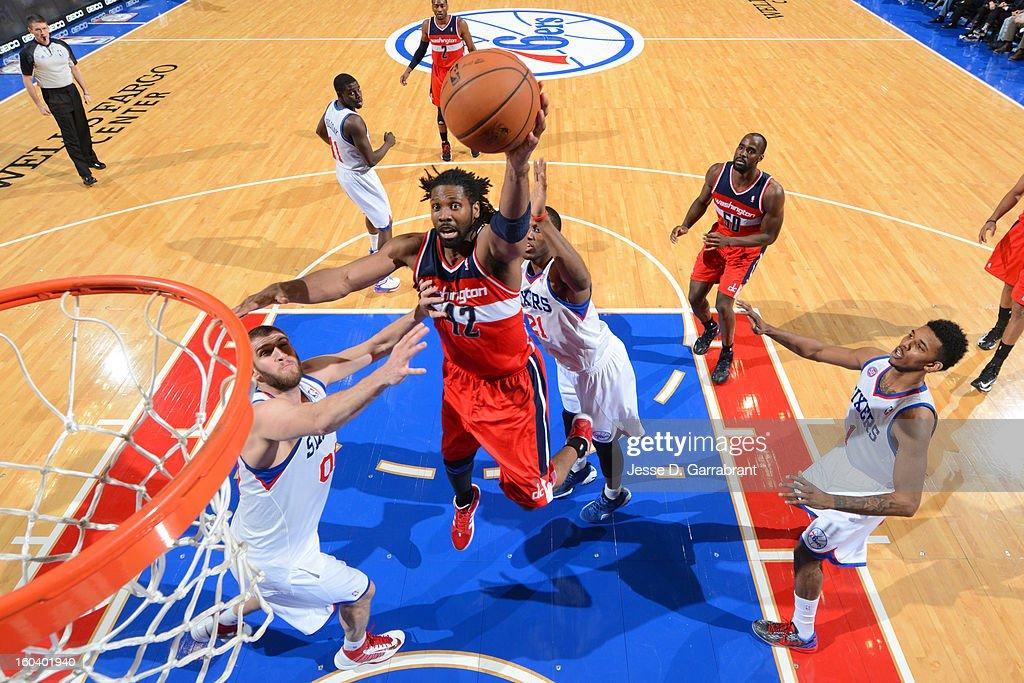 Nene #42 of the Washington Wizards shoots over Spencer Hawes #00 of the Philadelphia 76ers at the Wells Fargo Center on January 30, 2013 in Philadelphia, Pennsylvania.