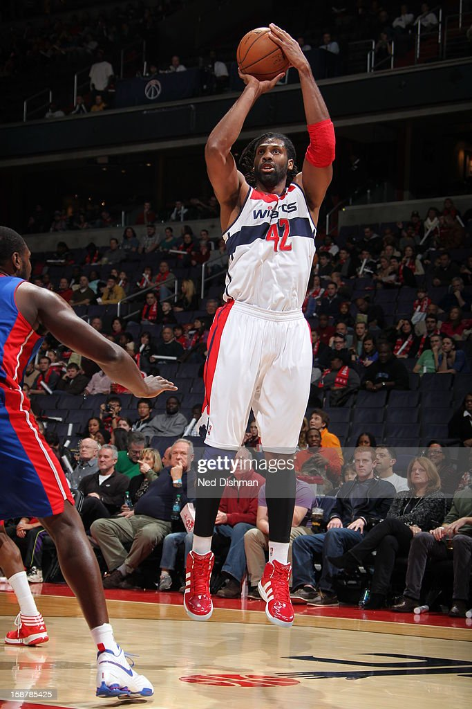 Nene #42 of the Washington Wizards takes a shot against the Detroit Pistons at the Verizon Center on December 22, 2012 in Washington, DC.