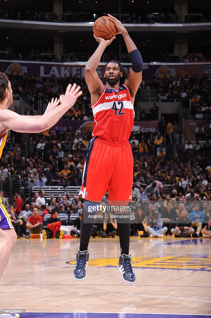 Nene #42 of the Washington Wizards takes a shot against the Los Angeles Lakers at Staples Center on March 22, 2013 in Los Angeles, California.