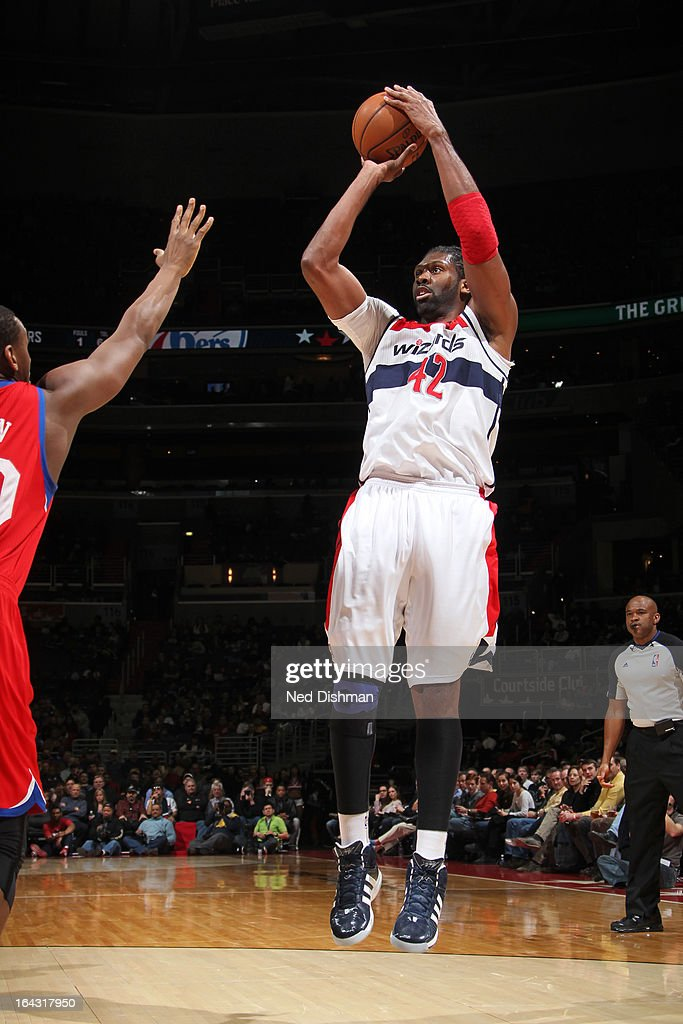 Nene #42 of the Washington Wizards takes a shot against the Philadelphia 76ers at the Verizon Center on March 3, 2013 in Washington, DC.
