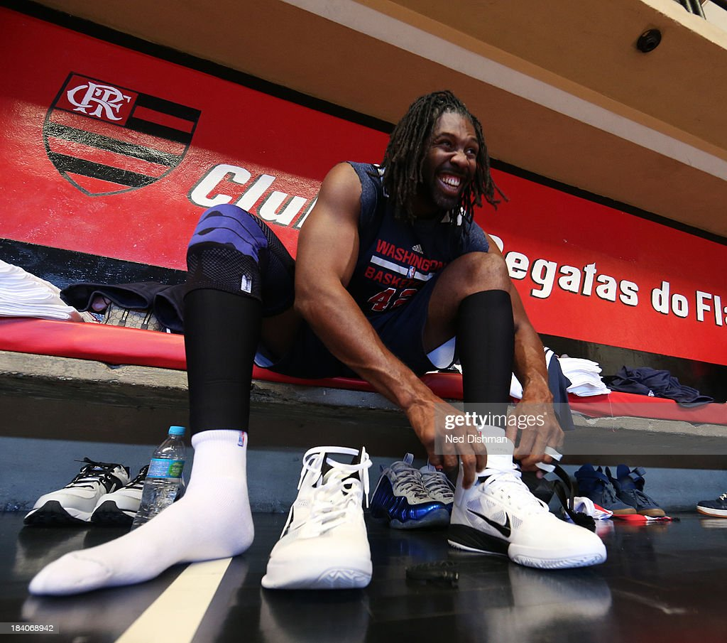 Nene #42 of the Washington Wizards ties his shoes during practice as part of 2013 Global Games on October 11, 2013 at Flamengo Club in Rio de Janiero, Brazil.