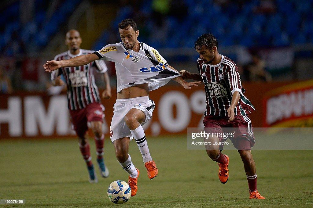 Nene (L) of Vasco battles for the ball with Gustavo Scarpa of Fluminense during the match between Vasco and Fluminense as part of Brasileirao Series A 2015 at Engenhao Stadium on November 1, 2015 in Rio de Janeiro, Brazil.