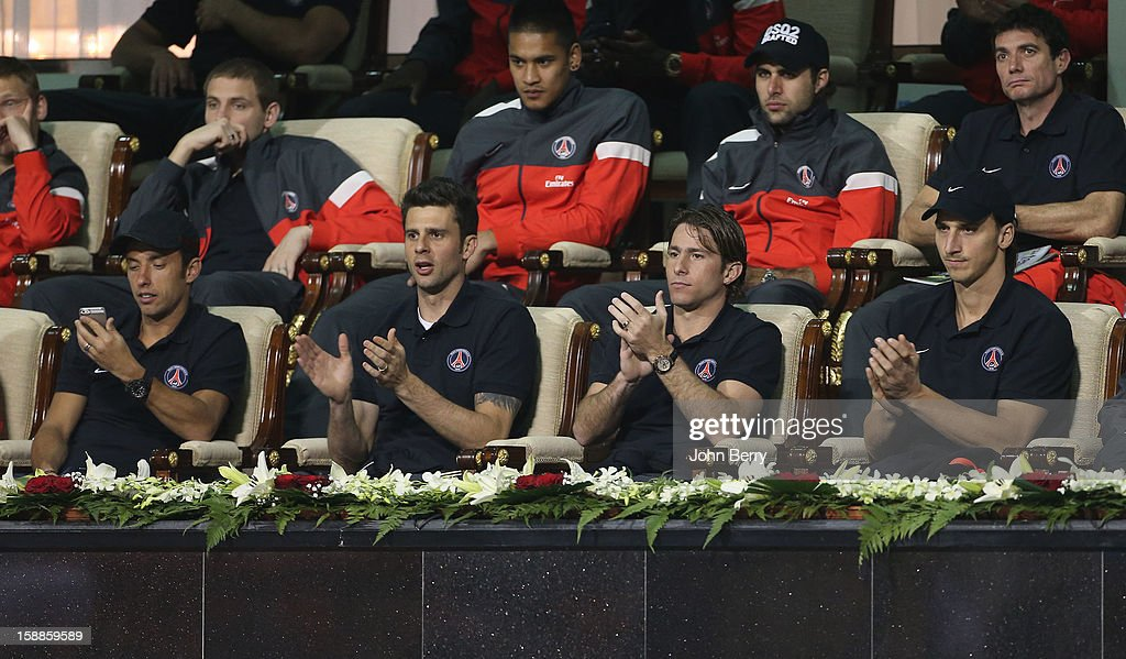 Nene, Thiago Motta, Maxwell, Zlatan Ibrahimovic, Marco Verratti, above Salvatore Sirigu of PSG watch David Ferrer of Spain against Dustin Brown of Germany during their first round match on day two of the Qatar Open 2013 at the Khalifa International Tennis and Squash Complex on January 1, 2013 in Doha, Qatar.