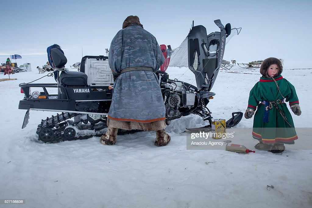 Nenet man prepares his snow motorcycle at 150 km from the town of Salekhard, Yamalo-Nenets Autonomous Okrug in Russia on May 2, 2016.