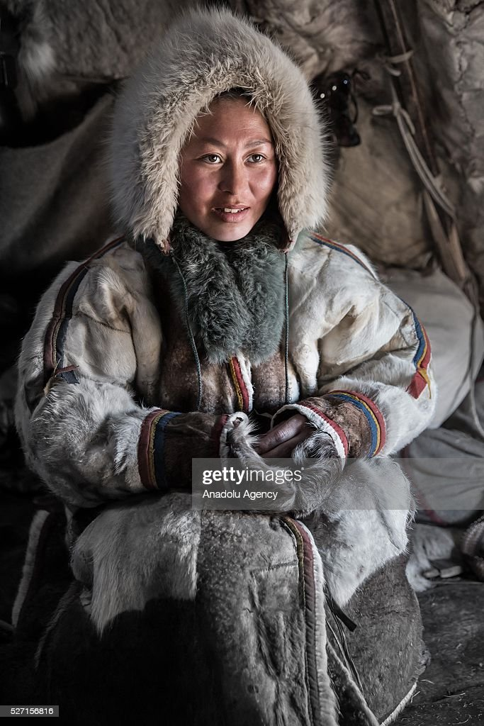 A Nenet woman poses for a photograph at Nomad camp, 150 km from the town of Salekhard, Yamalo-Nenets Autonomous Okrug in Russia on May 2, 2016.