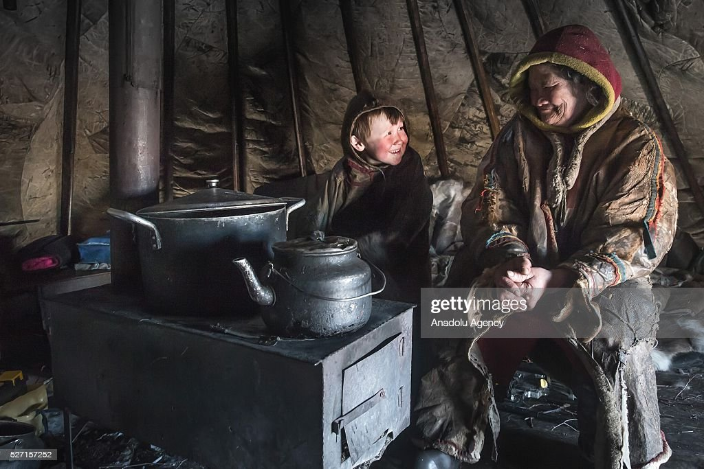 Nenets are seen inside their shelter at 150 km from the town of Salekhard, Yamalo-Nenets Autonomous Okrug in Russia on May 2, 2016.