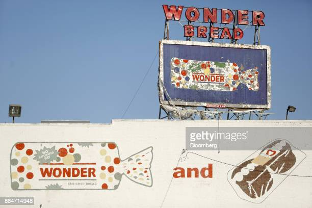 Neon and handpainted signage is displayed outside of the former Hostess Brands Inc Wonder Bread plant in Memphis Tennessee US on Tuesday Oct 3 2017...