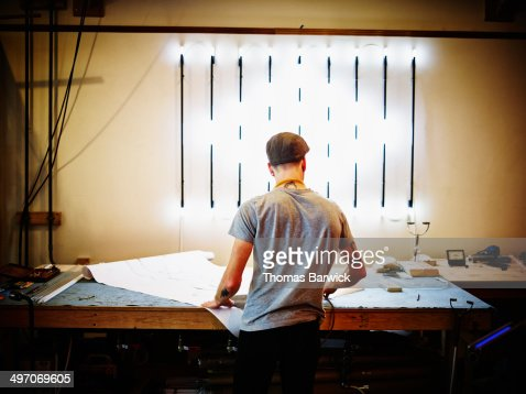 Neon artist at work table in industrial loft