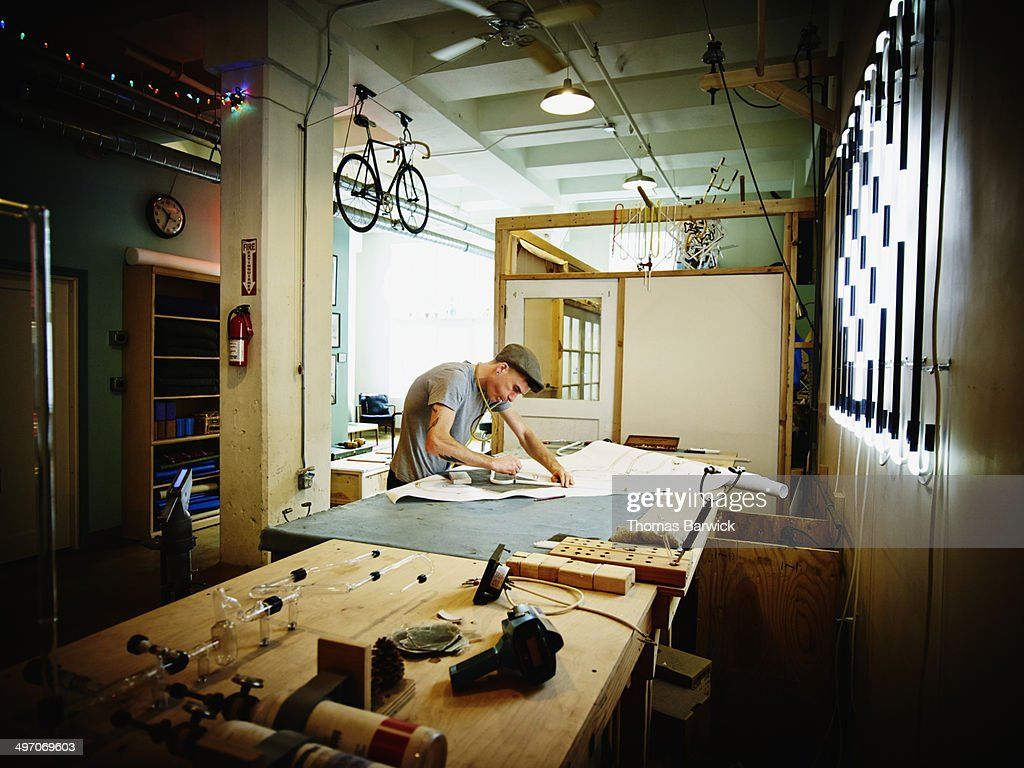 Neon artist bending glass tube for neon sign : Stock Photo