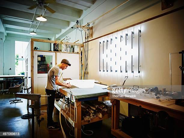 Neon artist working in industrial loft