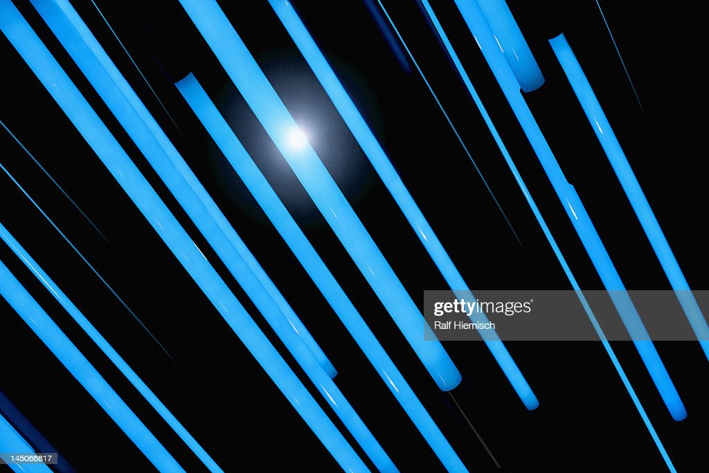 Neon blue rods of glowing light