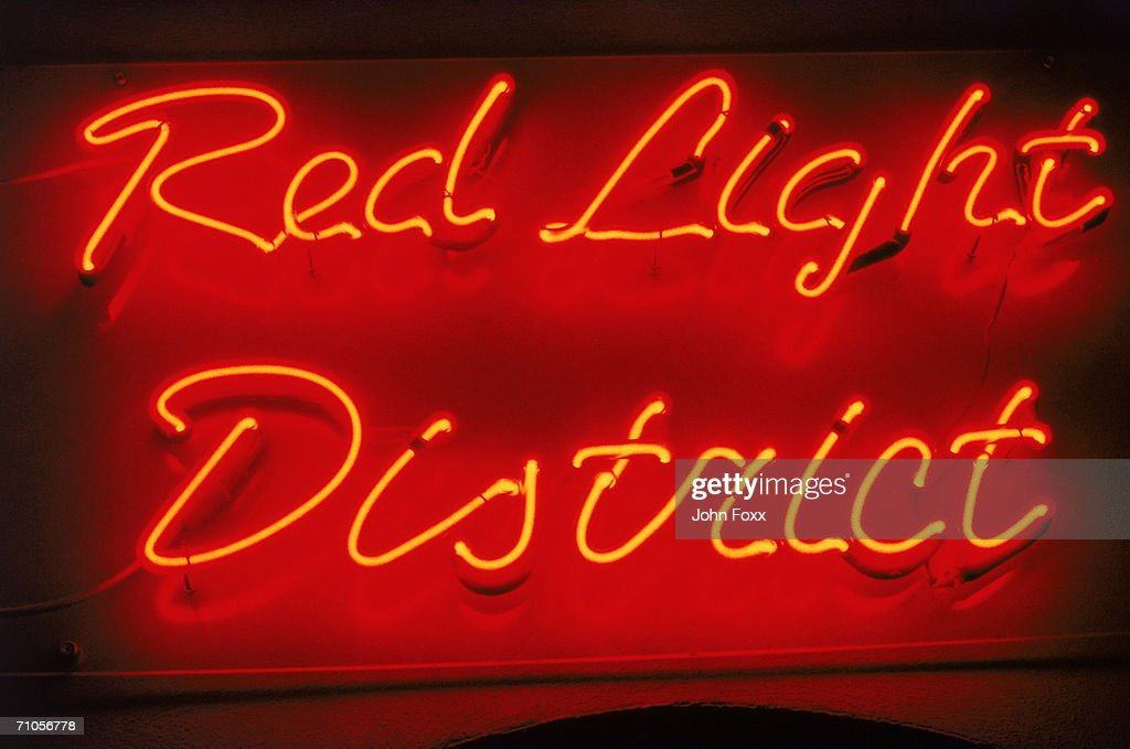 Neon district sign, close-up : Stock Photo