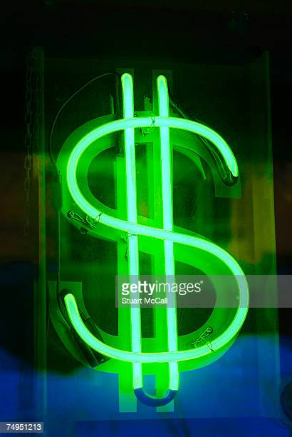 Neon dollar sign in shop window, close-up