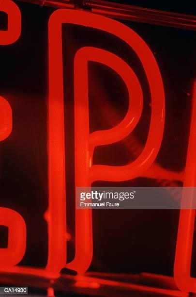 Neon letter 'P', close-up